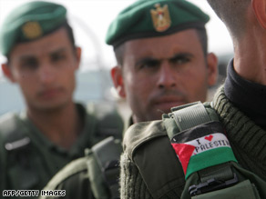 Palestinian security officers assemble Saturday in the West Bank town of Hebron.