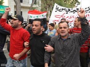 Iraqi refugees took to the streets in Damascus, Syria, on Wednesday to protest Sunday's airstrike.