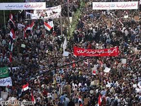 Thousands of Syrians march Thursday in Damascus to protest a cross-border U.S. air raid.