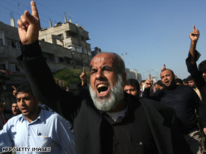 Palestinians shout during Wednesday's funeral of five militants killed Tuesday in an Israeli army operation.
