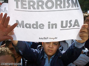 Palestinian refugee schoolboys in Damascus protest the U.S. attack in Syria, which called the strike barbaric.