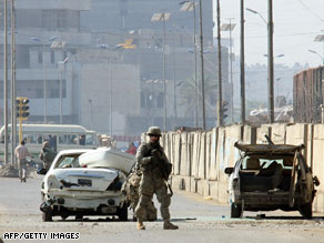 A U.S. soldier secures the site of a bombing Thursday in central Baghdad.