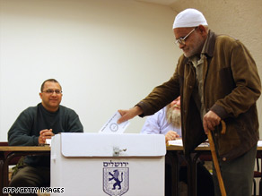 A Palestinian resident of Jerusalem casts his ballot in that city's mayoral election Tuesday.