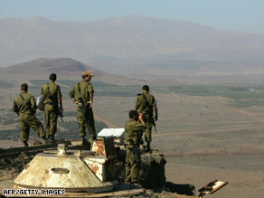 Israeli soldiers deployed in the Golan Heights look toward Syria following the attack last year.