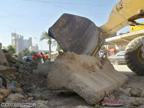 Barricades are removed Tuesday from a Baghdad street that formerly was closed due to fears of vehicle bombs.