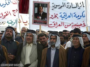 Shiite Muslim tribal leaders march Wednesday in Karbala in support of the U.S.-Iraq security agreement.