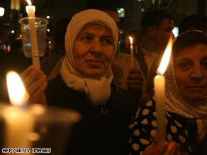 Palestinian women hold candles during a vigil protesting the Israeli blockade of the Gaza Strip.