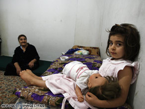 In late November, members of a Christian Iraqi family sit in a home in Lebanon after fleeing violence in Mosul.