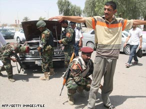 Iraqi Interior Ministry troops conduct inspections at a checkpoint in the southern Iraqi city of Basra in May.