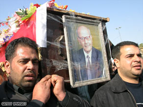 Iraqis carry the coffin of reporter Shihab al-Timimi, who died of gunshot injuries in February.