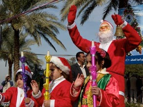 Iraqi children dress like Santa's elves for the Christmas party.