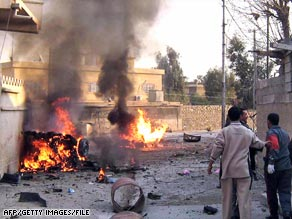 Iraqis rush to a car bomb explosion at a Christian church in Kirkuk in January.
