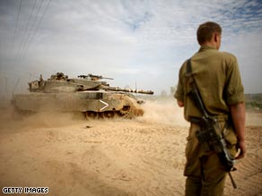 An Israeli tank maneuvers during a deployment near the Israeli border with Gaza.