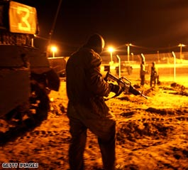 http://i2.cdn.turner.com/cnn/2008/WORLD/meast/12/27/gaza.israel.strikes/t1home.idf.prepares.gi.jpg