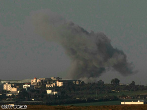 Smoke rises after an Israeli air force attack against Hamas militants in Gaza on Sunday as seen from Israel's border.