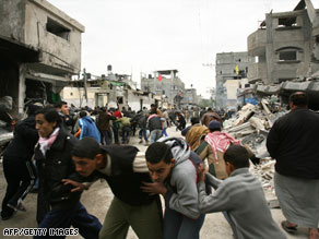 Palestinian civilians run during an Israeli airstrike in the Jabalya refugee camp in Gaza on Monday.