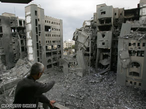 A Palestinian man surveys a Hamas government compound after an Israeli airstrike Tuesday.