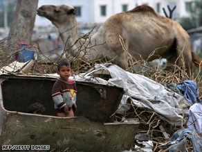 Impoverished Palestinian children play amid rubbish in a poverty-stricken southern Gaza City neighborhood.