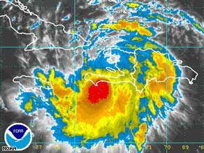 An infrared image shows Tropical Storm Fay just off Haiti on Saturday, heading west toward Cuba.