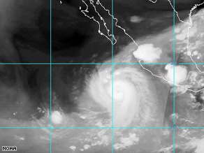 A satellite image shows Tropical Depression Marco over east-central Mexico on Tuesday afternoon.