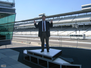 CNN's Mark Preston at the Indianapolis Motor Speedway. Obama and McCain are vying for the support of the tens of millions of race car enthusiasts – fans that would fill the stands of venues such as the hallowed grounds at Indy. Credit: CNN's Alec Miran.