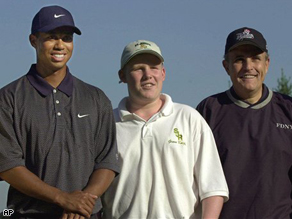 Andrew Giuliani, center, and his father Rudolph Giuliani, right, pose with Tiger Woods in 2001