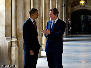 Sen. Barack Obama listens to British Tory Leader David Cameron Saturday in London.