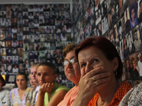 Survivors of the Srebrenica massacre react while listening to news about former Bosnian Serb leader Radovan Karadzic during his appearance at the U.N.'s war crimes tribunal.