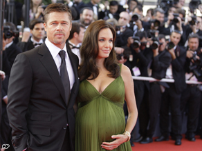 Angelina Jolie and Brad Pitt were paid $14 million for photos of their twins.