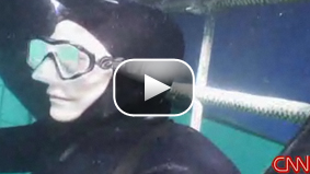 Watch Anderson Cooper in the water with great white sharks off the coast of South Africa.