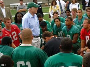 Sen. John McCain gives the Marshall University football team a pep talk during practice, Wednesday.