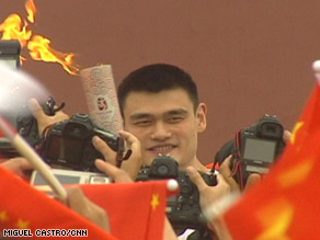 Another face in the crowd: Yao Ming carries the Olympic torch in Beijing.