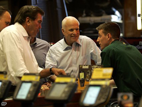 Sen. John McCain and former Pennsylvania Gov. Tom Ridge shop at the Bass Pro Shops Outdoor World Monday.