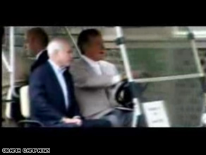New Obama ad uses footage of McCain being driven in a golf cart by former President George H.W. Bush.