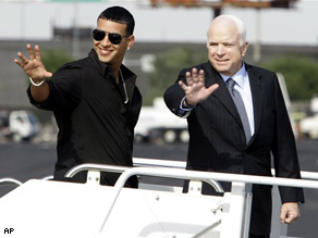 Sen. John McCain and Puerto Rican reggaeton star Daddy Yankee waves as they board the Straight Talk Air campaign charter airplane in Phoenix, Ariz., Monday.