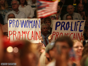 Supporters hold signs at McCain's vice presidential announcement Friday.