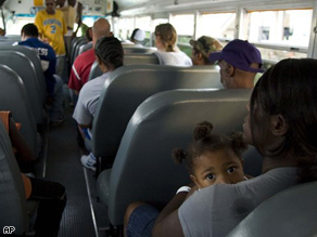 Residents wait on an evacuation bus at the Lake Charles Civic Center.