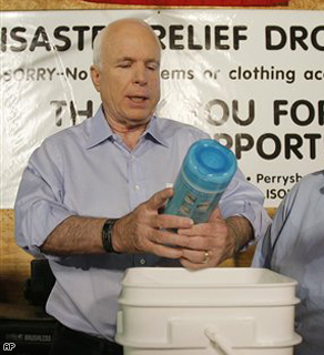 Sen. John McCain helps pack Hurricane Gustav relief packages at the ISOH/Impact charitable organization's facility in Toledo, Ohio, Monday.