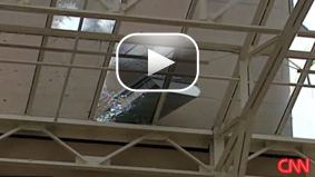Watch the footage of large debris slamming into the glass roof of the Sheraton hotel in Baton Rouge.