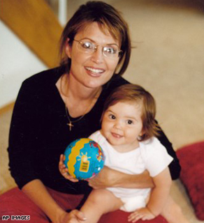 This undated photo provided by the Heath family shows Alaska Gov. Sarah Palin with her daughter Piper in Wasilla, Alaska.