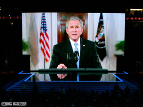 President George W. Bush address the convention via satellite.