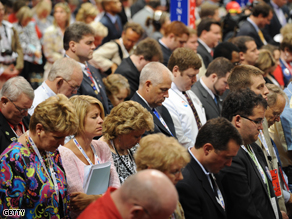 Delegation members in prayer at the Republican National Convention 2008 in St. Paul, Minnesota, Monday. The political jamboree's opening day turned into a Hurricane Gustav fundraising effort.