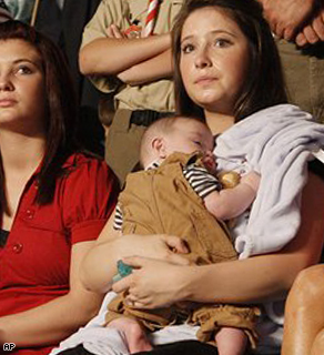 Bristol Palin, 17, holds her brother Trig during the campaign rally