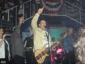 Former Arkansas Gov. Mike Huckabee plays the guitar with his band, Capitol Offense, at a party during the RNC-week festivities.