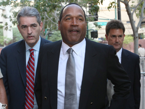 O.J. Simpson and his lawyers arrive at court today.