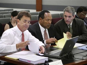 O.J. Simpson withlawyers Gabriel Grosso, right, and Yale Galanter during the second day of the jury selection in Las Vegas.