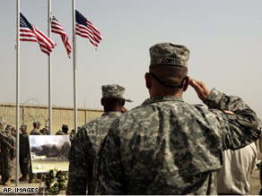 U.S. Army soldiers salute three American flags, representing the three sites of the September 11 terrorist attacks on the United States, at a ceremony to mark the seventh anniversary at Camp Liberty in Baghdad.