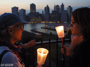 New Yorkers gather to hold a vigil to remember the victims of the 9/11 attacks.