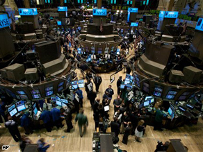 Traders work on the floor of the New York Stock Exchange on Monday, in New York.