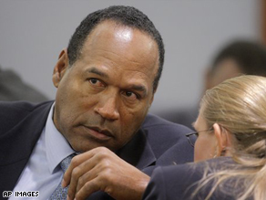 O.J. Simpson speaks to a member of his defense team.